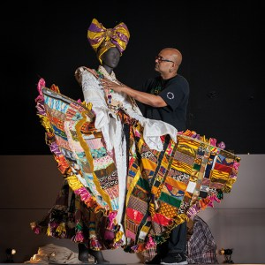 Brixton-based designer Ray Mahabir with his costume commisioned by the British Library. Photo by Toby Keane
